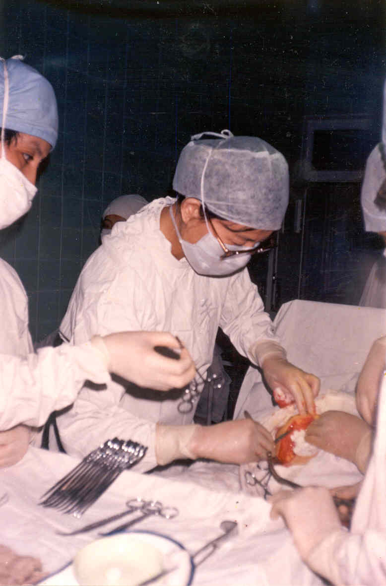 Dr. Ma porforming surgery when she was in China.